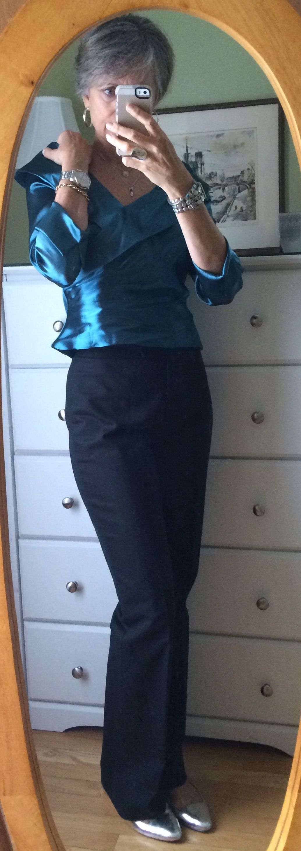 Shiny jade blouse with black pants for a mid-week  event.