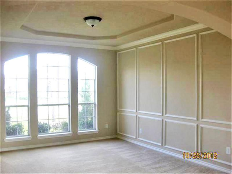 formal living room accented with picture frame molding and a coffered ceiling