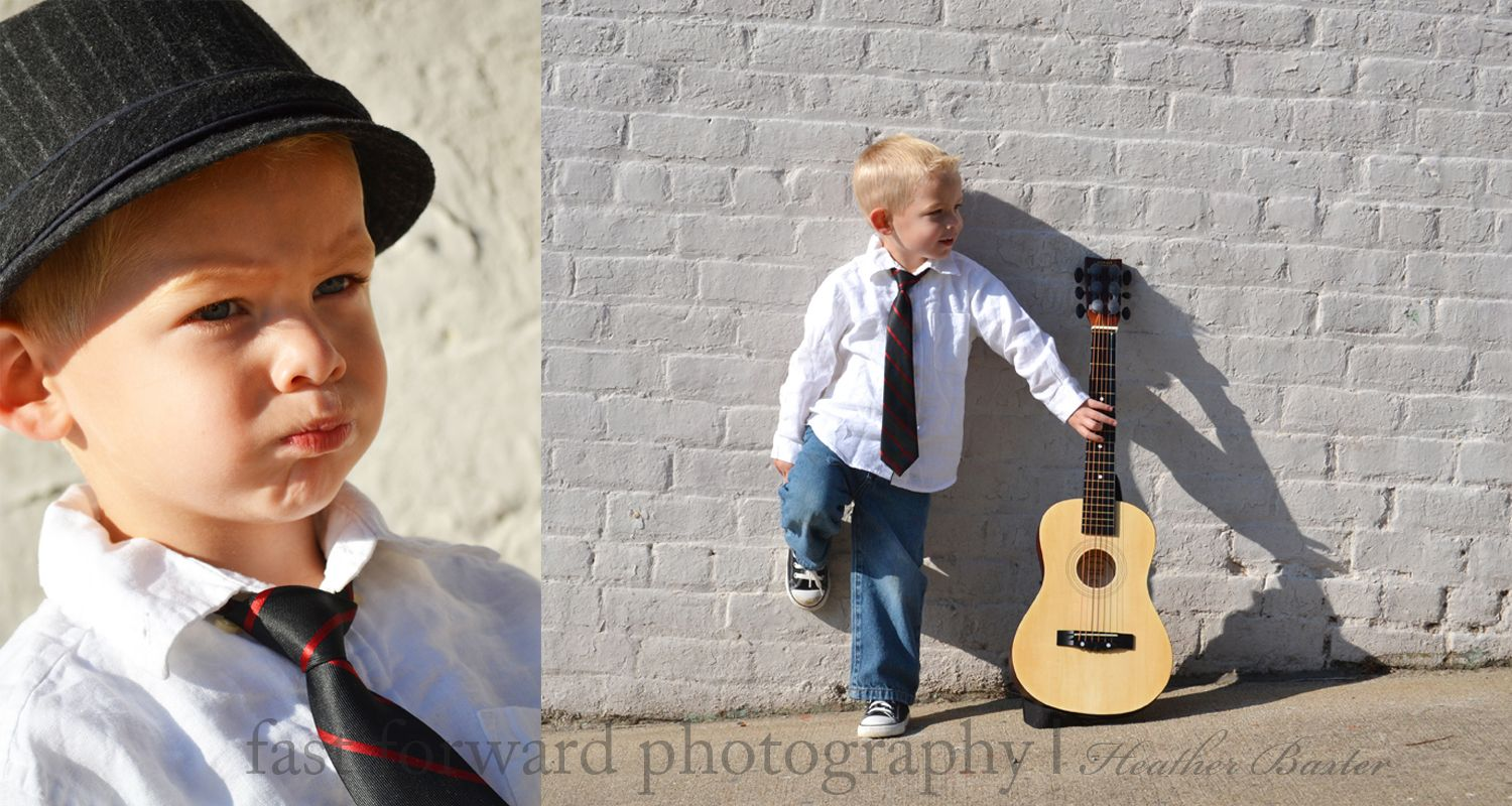 child photography downtown photography guitar fedora and black tie 3 year old boy child pose white wall