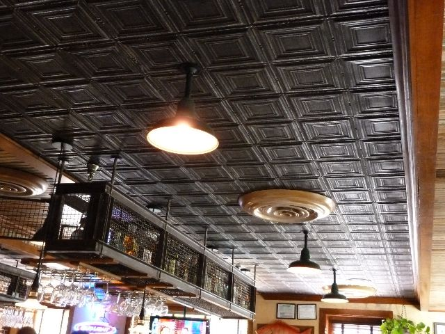 Ceiling possibility for our living room/kitchen/dining room? Tin Ceilings  by The