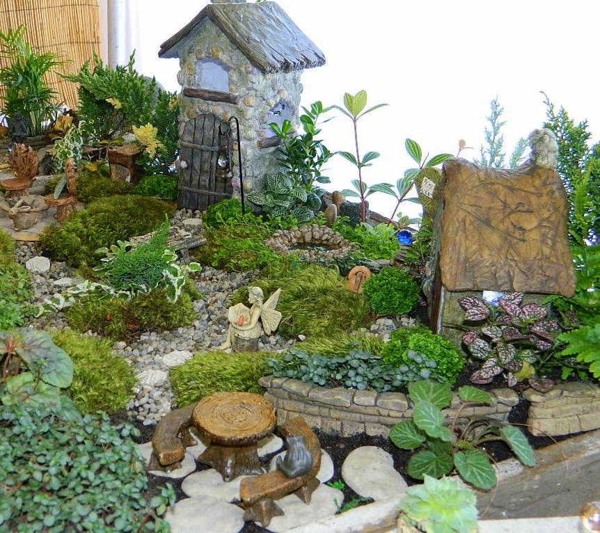 Love this! I would love this to be my backyard!  www.wholesalefairygardens.com