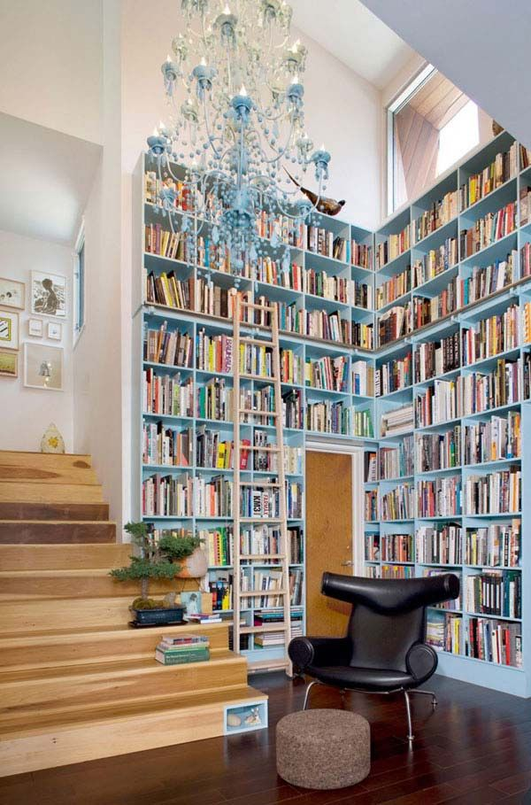 Colored bookcase!  And matching chandelier.  What a perfect way to utilize an otherwise dead space.