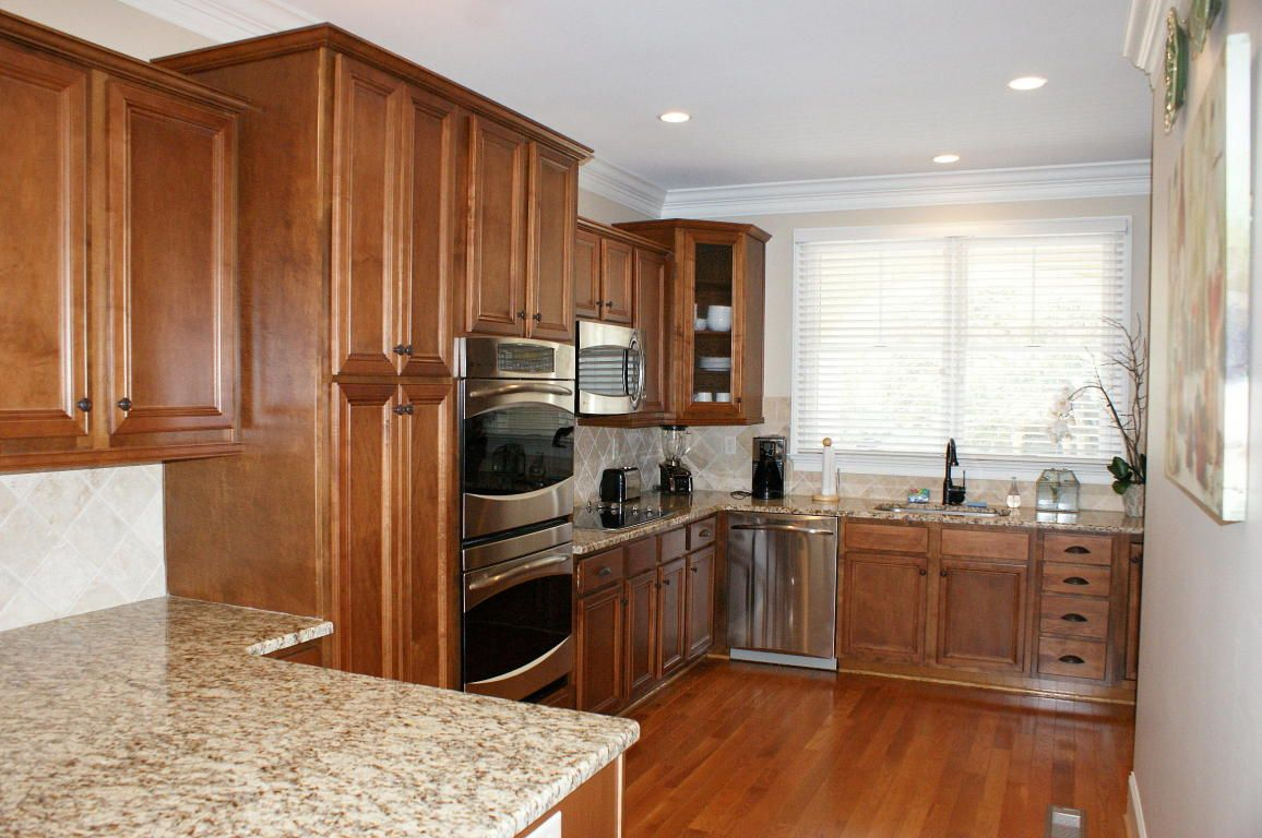 Low window behind kitchen sink  beautiful custombuilt townhome located in the ocean winds area
