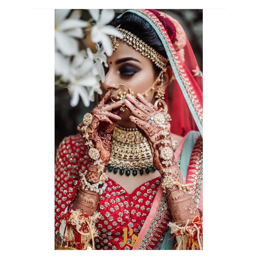 In Love With Smoky Eye Makeup Paired With Traditional Red Lehenga