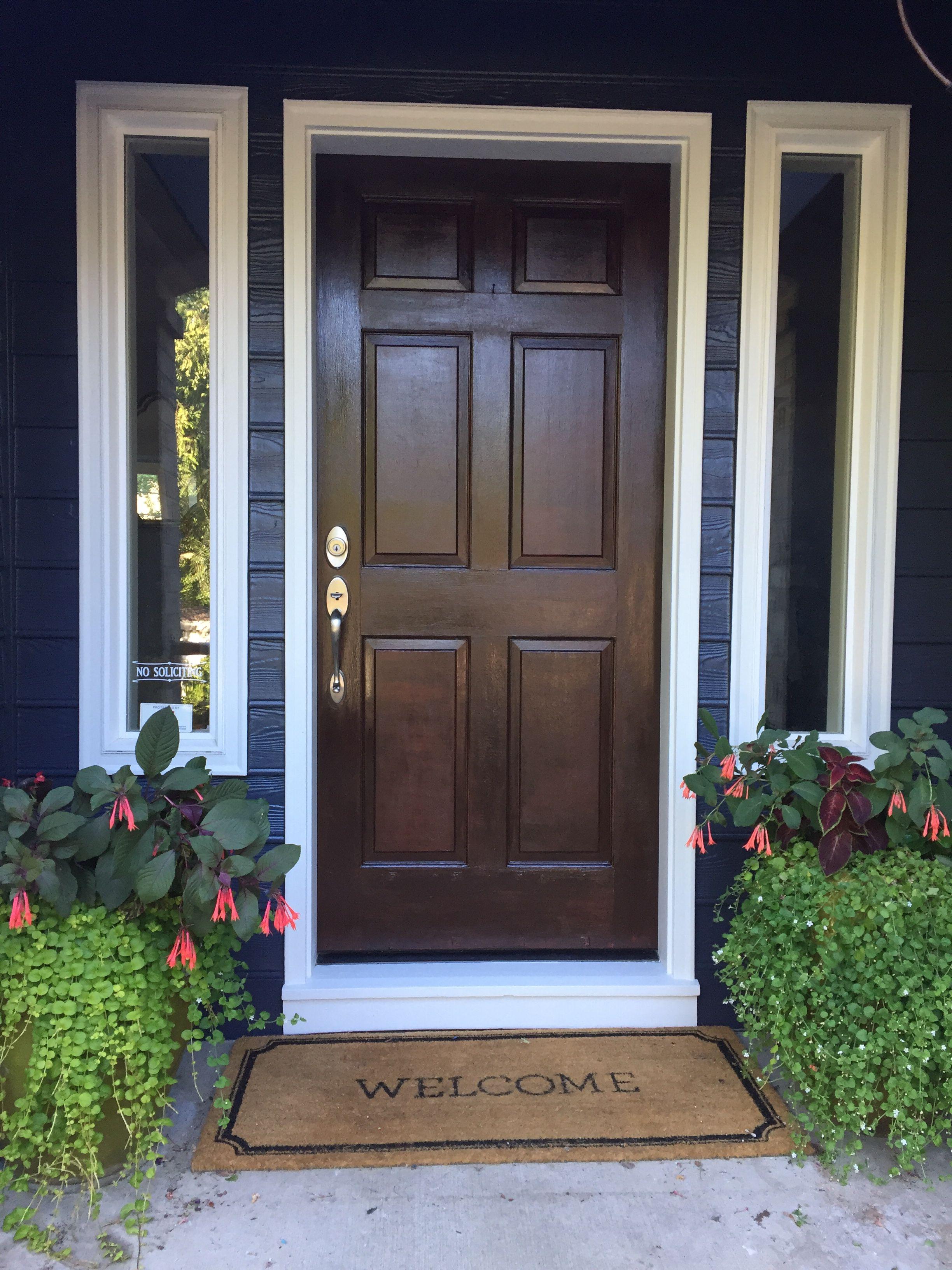 Dark Blue House, White Trim, Faux Wood Doors