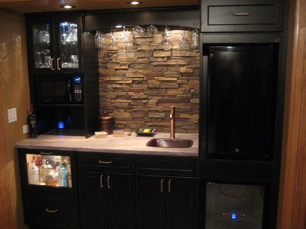 Small Kitchen With Natural Stone Backsplash And Black Cabinet Idea