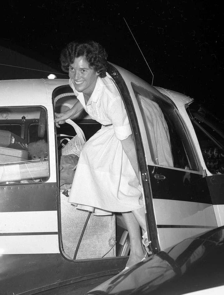 Betty Miller steps out of the Piper Apache at Brisbane, Queensland, Australia, 13 May 1963