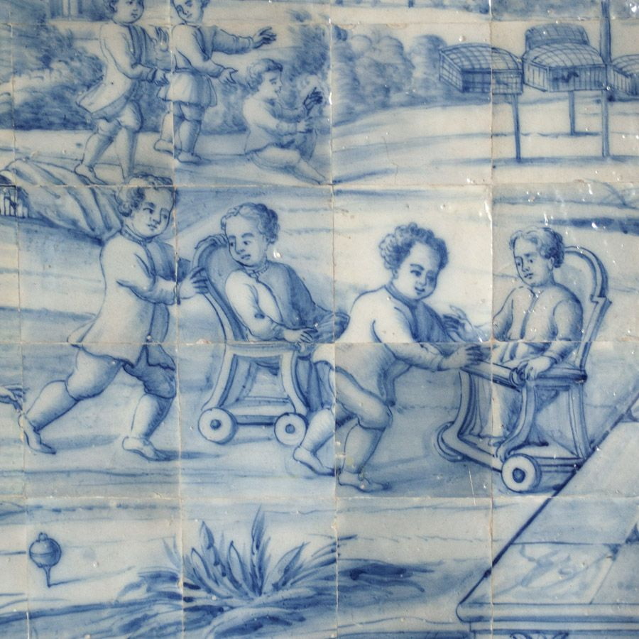 In one of the Salons, a blue tiled scene depicts children playing ...