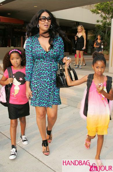 Kimora Lee Simmons and her daughters, and she is always stylish even with two kids.