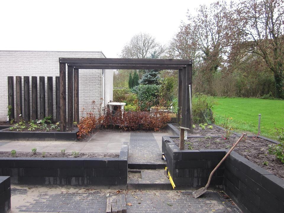Kunstobjecten Voor Tuin : Robuuste bielsen verwerkt als kunstobject in particuliere tuin
