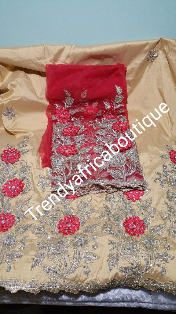5cd302914b2a69 Nigerian Tranditional George wrapper. Embriodery/stones design in  Champagne/coral red matching blouse.