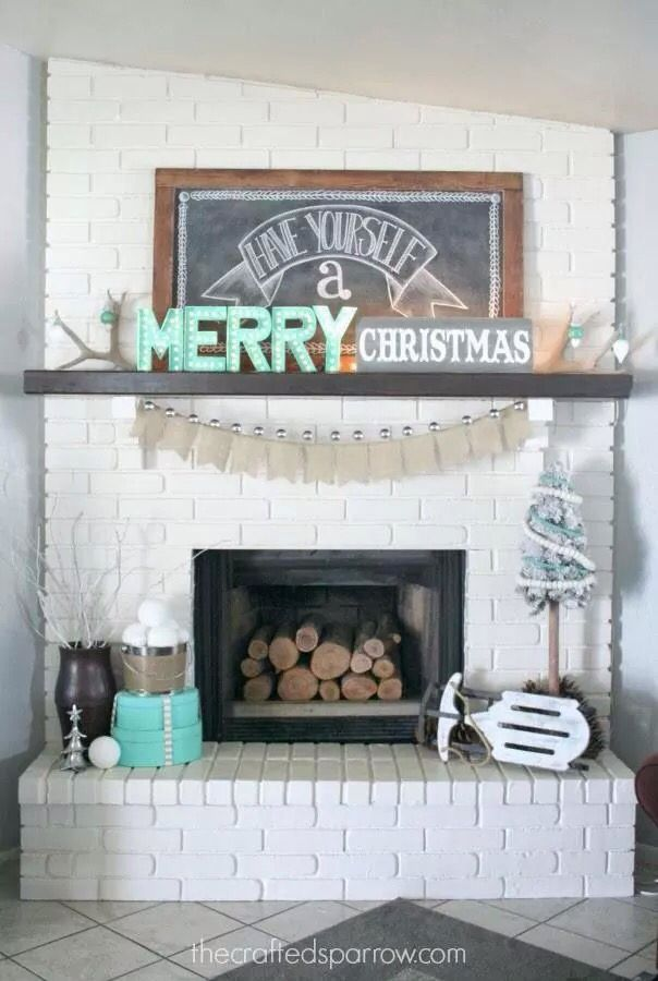"""Adorable Christmas mantle idea! Turquoise and chalkboard accents. """"Have yourself a merry Christmas."""""""