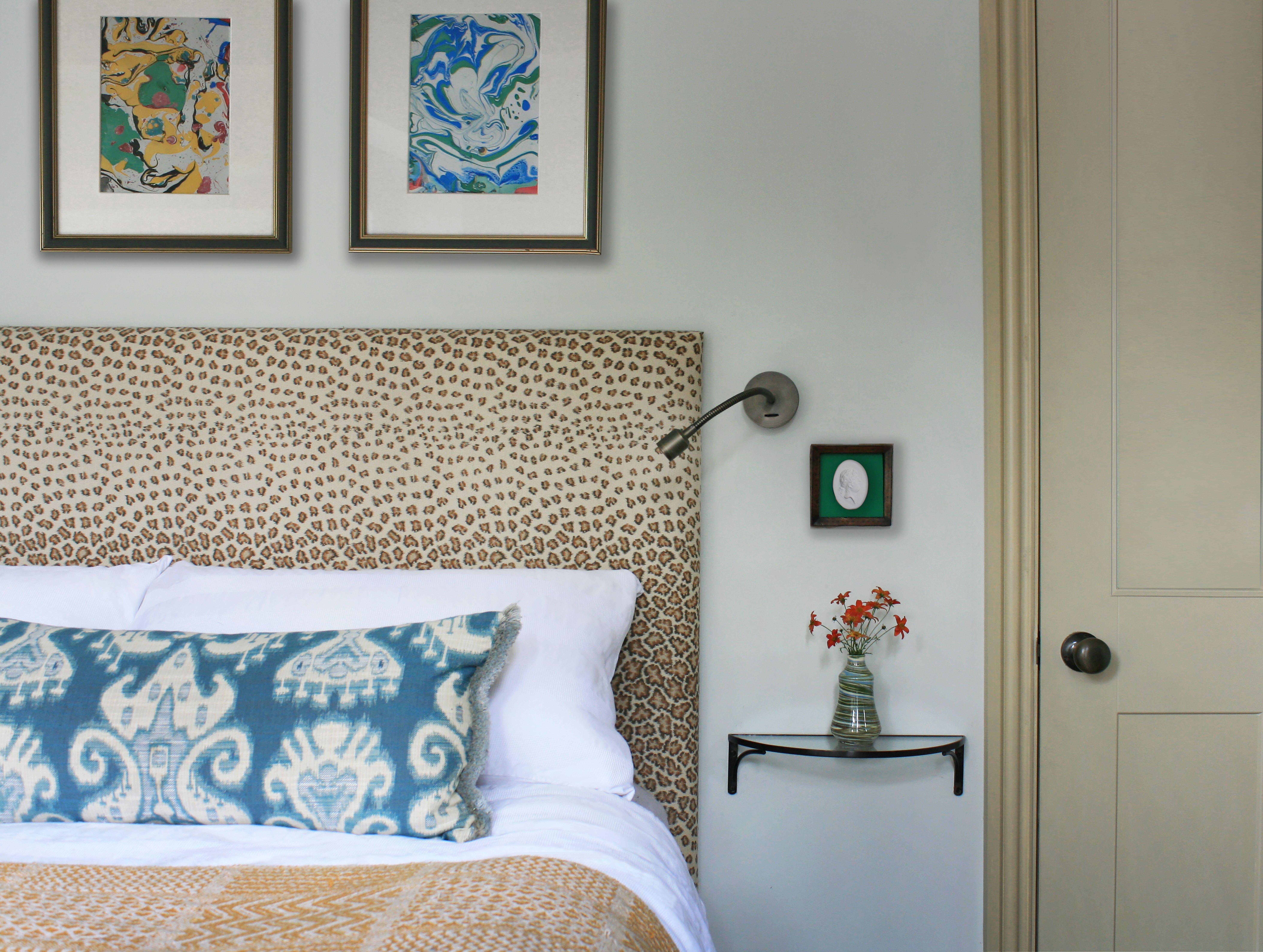 Leopard print headboard, marble artwork, small bedroom