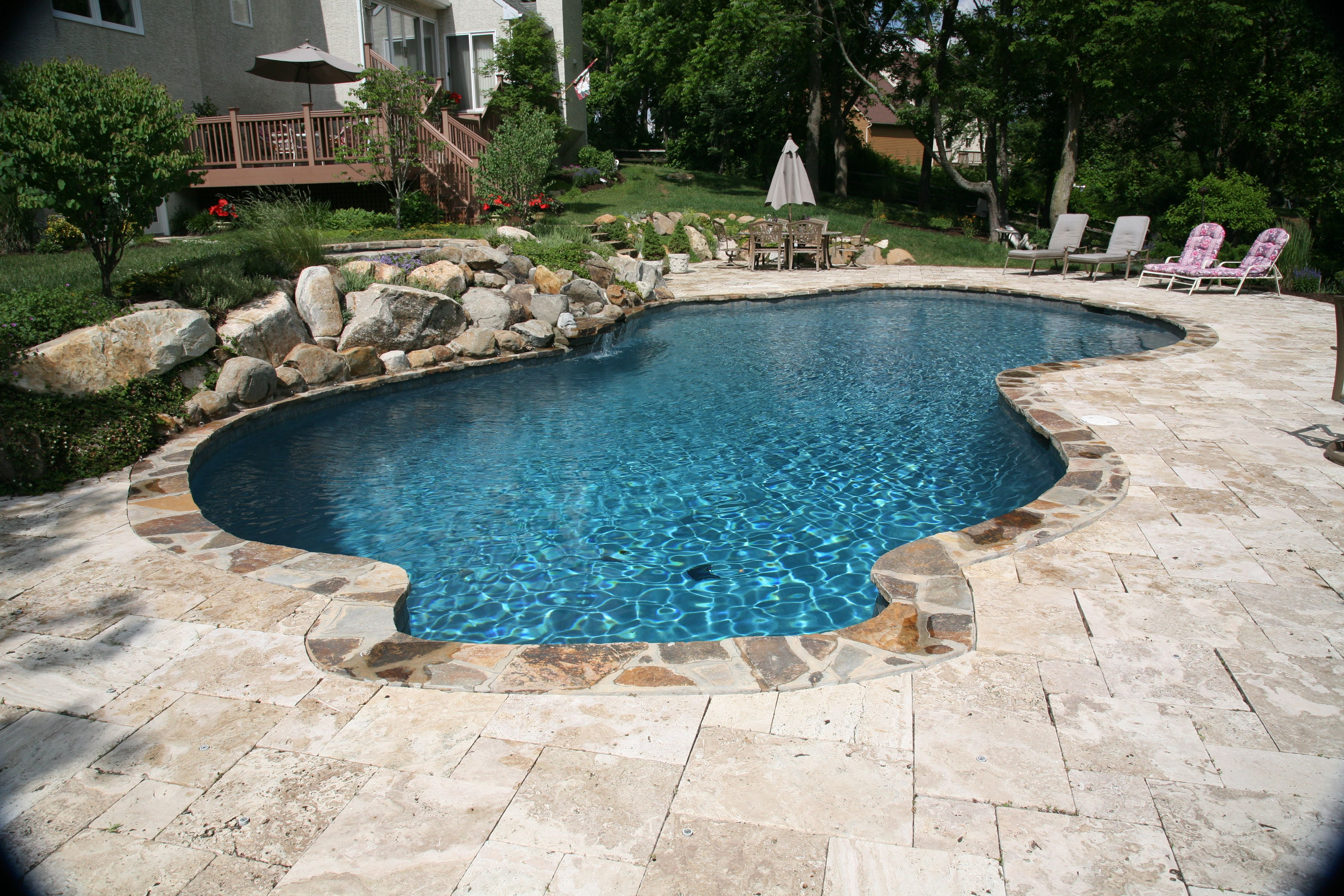 Free form in ground concrete/plaster/gunite pool. Stone coping ...