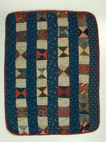 Discharge Printing quilt: Hourglass Strippie doll quilt made between 1870 - 1890