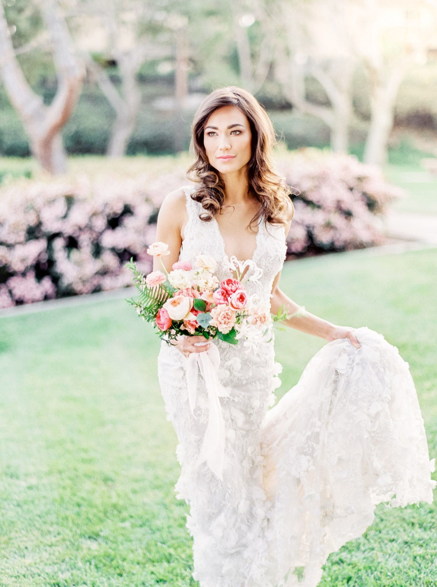 9832496e Bride wearing a Marchesa Daffodil sleeveless gown. Bridal hair with glamorous  waves and soft makeup