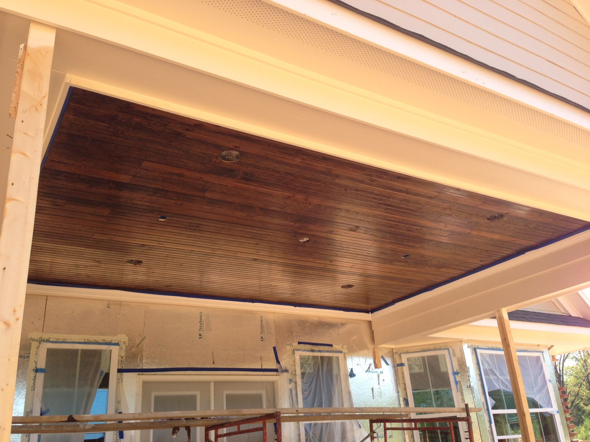 Our patio ceiling! Tongue / groove wood with a dark stain