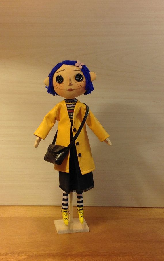 Textile Art Doll Coraline With Her Button Eyes Blue Hair And Yellow Raincoat This Decorative Fabric Doll Is Coraline Doll Textile Art Dolls Coraline Movie