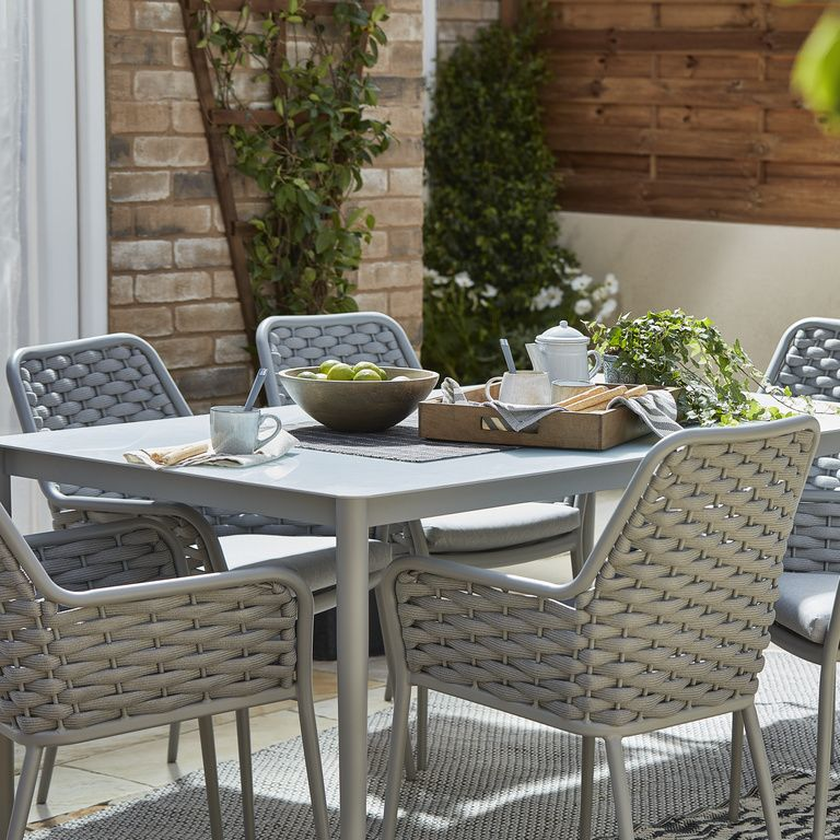 c9f6a0386d14 The chairs in the Mayotte dining set fit perfectly under the table to  create space when