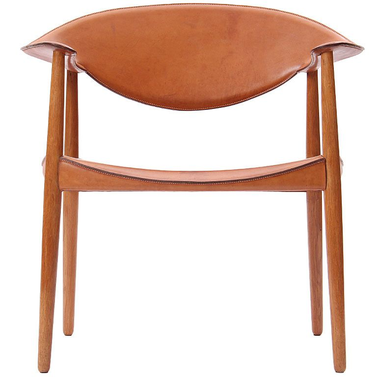 Saddle Stitched Metropolitain Chair by Larsen and Madsen  Denmark  1950's  An easy chair / desk chair with seat, back and arms finely finished with saddle stitched leather on an oak frame designed by A. Bender Madsen and Ejner Larsen, cabinetmaker, Willy Beck, Saddle leather work by Dahlman 1959