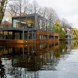 A visually stunning home along the waterway which is secluded and banked down below street level to have a serene and vacation like feel.