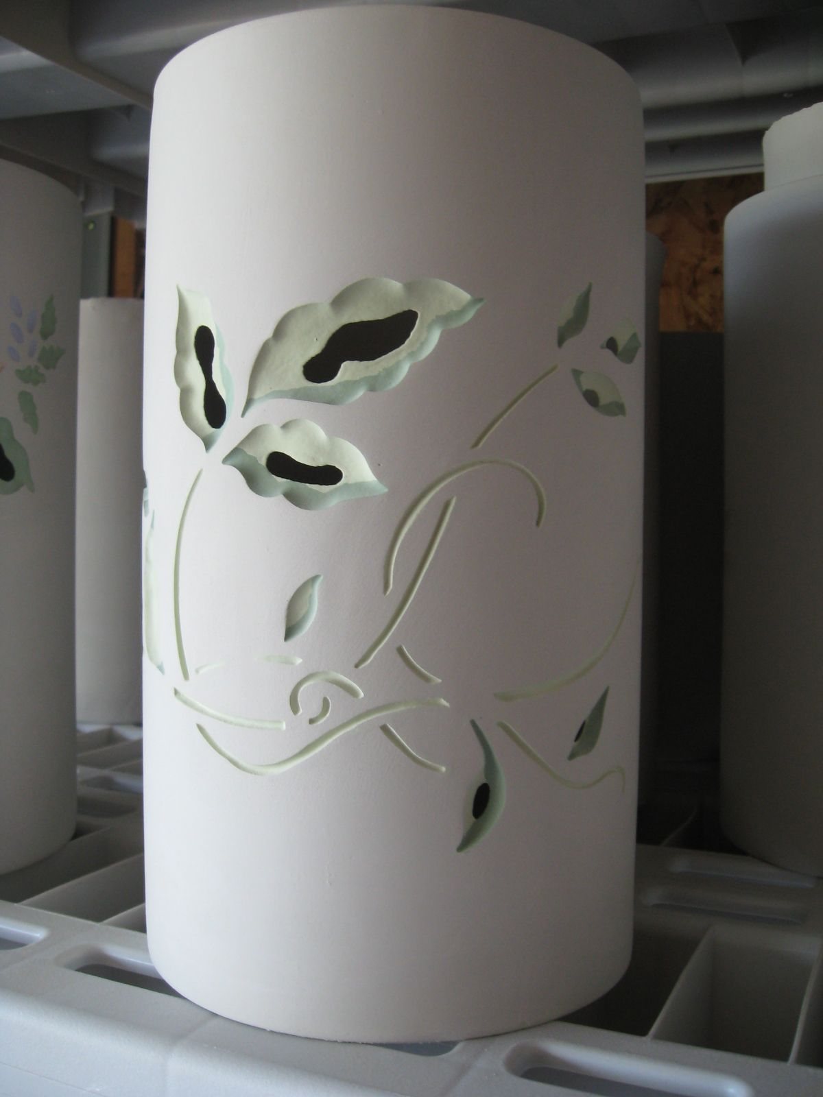 Hand painted and carved by Rich at Peace of Earth Ceramics