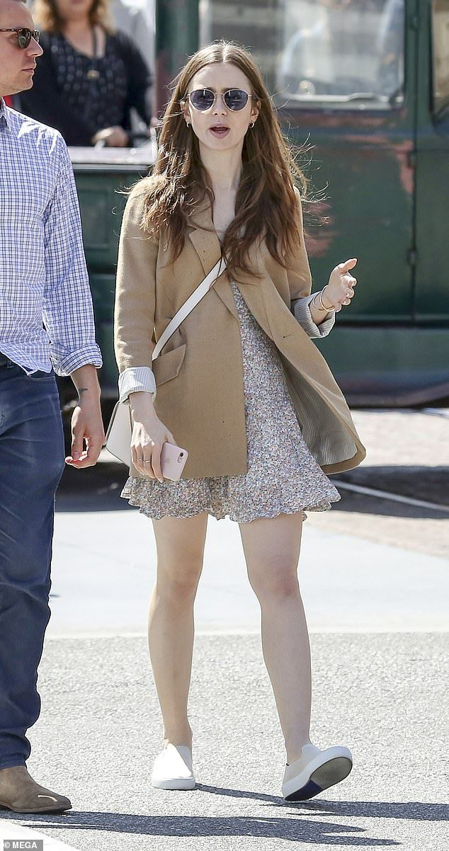 Lily Collins pairs mini dress with blazer for relaxed outing in LA