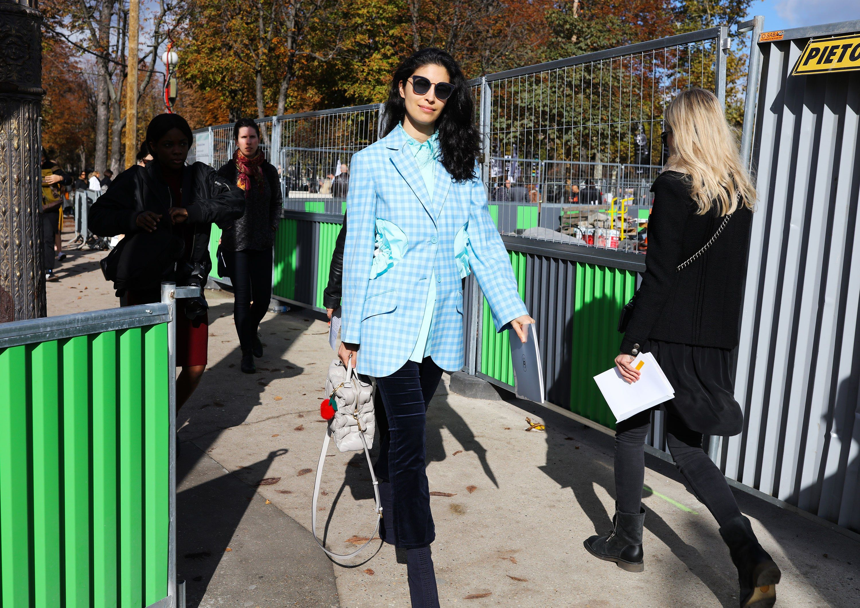 a8e821bd09c Caroline Issa wearing Nina Ricci with an Anya Hindmarch bag + check blazer