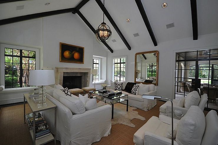 Amazing Living Room With Vaulted Ceiling Accented Dark Wood Beams And Restoration Hardware Victorian Hotel