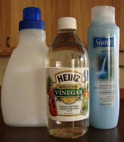 Homemade Fabric Softener!  What You'll Need:  6 cups HOT water  3 cups white vinegar  2 cups Suave Refreshing Waterfall Conditioner {or other favorite scent}  What You'll Do:  Mix conditioner & hot water well, until conditioner is dissolved completely.  Add the vinegar, and mix well.  Store in a large container {empty fabric softener container, empty large vinegar bottle, etc}  Pour into a downy ball… or use approx. 2 tbsp. in the fabric softener spot in your laundry machine… then wash!