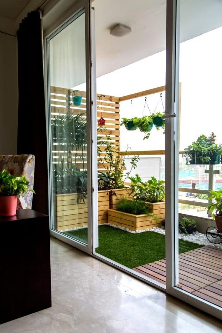 Love that wood strip wall/trellis. Building it out of the side, it