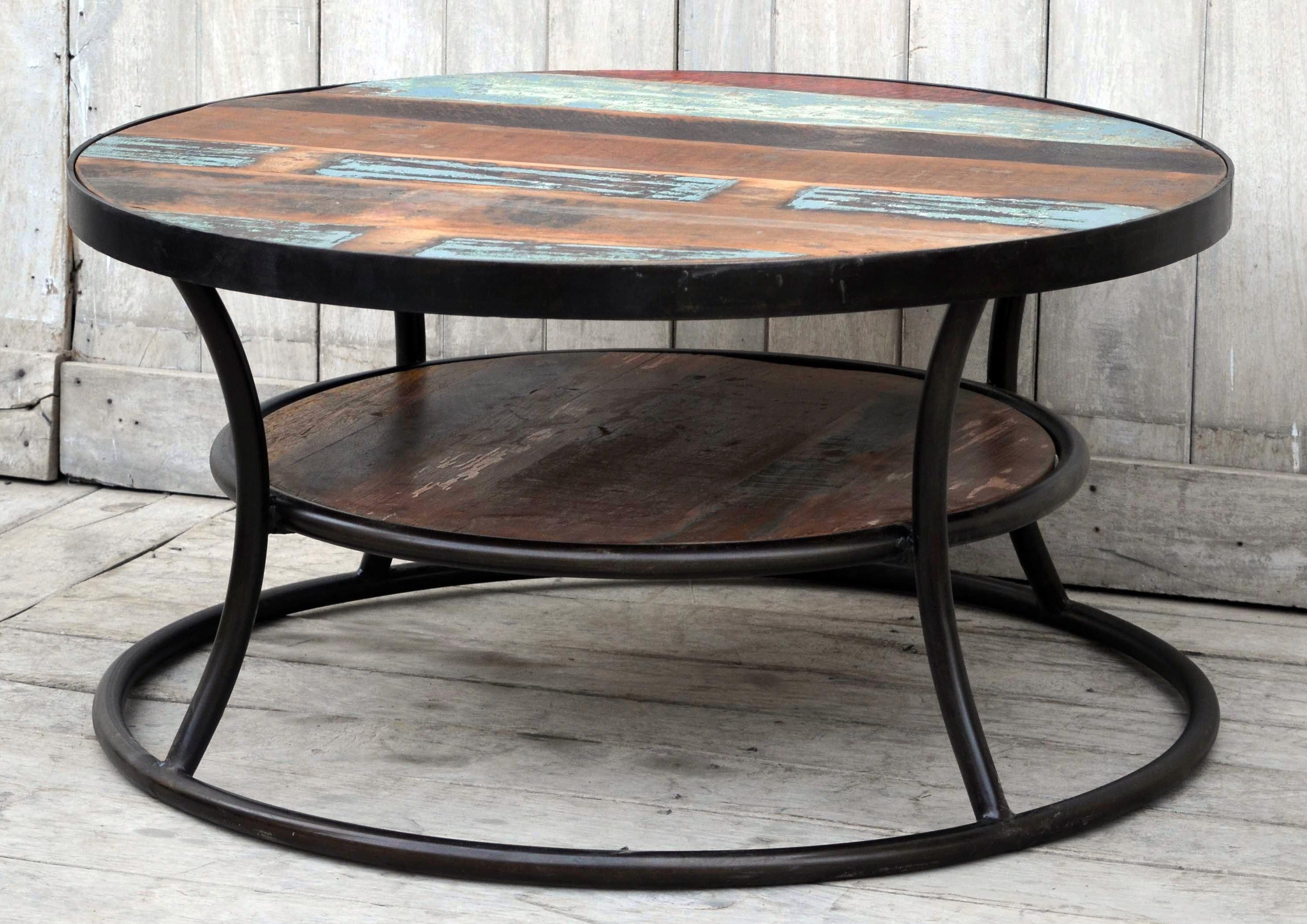 The wally tyre shaped hardwood mango and cast iron round coffee the wally tyre shaped hardwood mango and cast iron round coffee table geotapseo Image collections