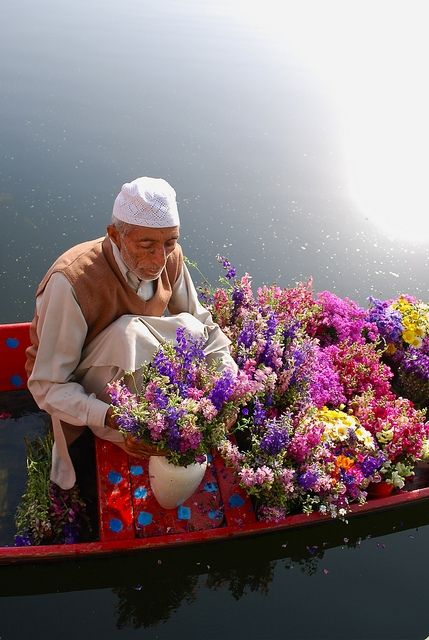 Kashmiri Flower Vendor on his shikara