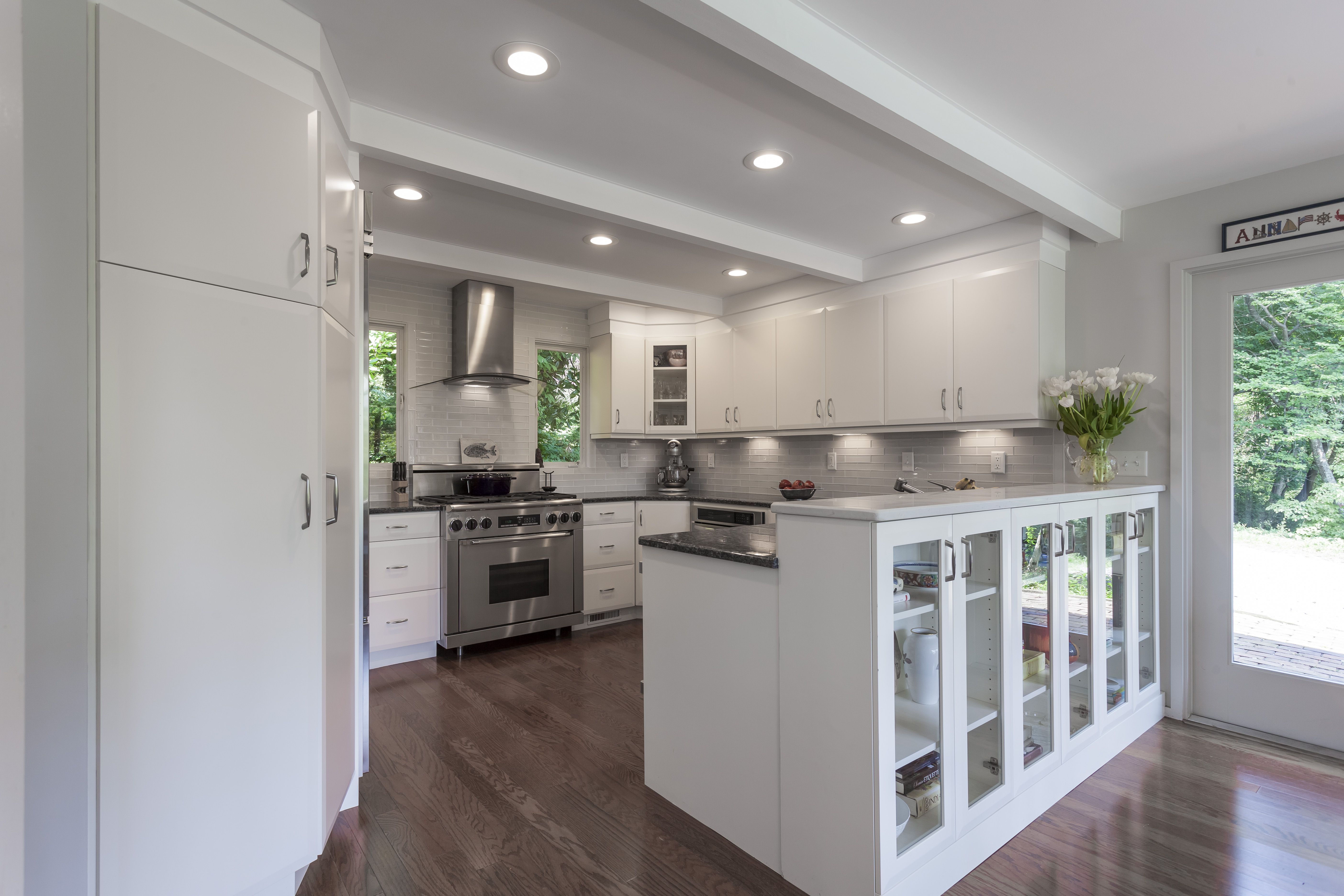 Elmwood Cabinetry, White Modern Kitchen, Small Kitchen, Glass Hutch Front  Cabinets, Angled