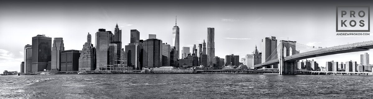 Panoramic skyline of lower manhattan from brooklyn black white photo by andrew prokos new york