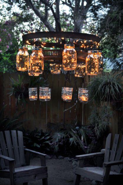 A Cool Recycled Mason Jar Chandelier Outdoor Room Garden Chandelier This Is Made With Mason Ja Diy Outdoor Lighting Terrace Garden Design Backyard Lighting