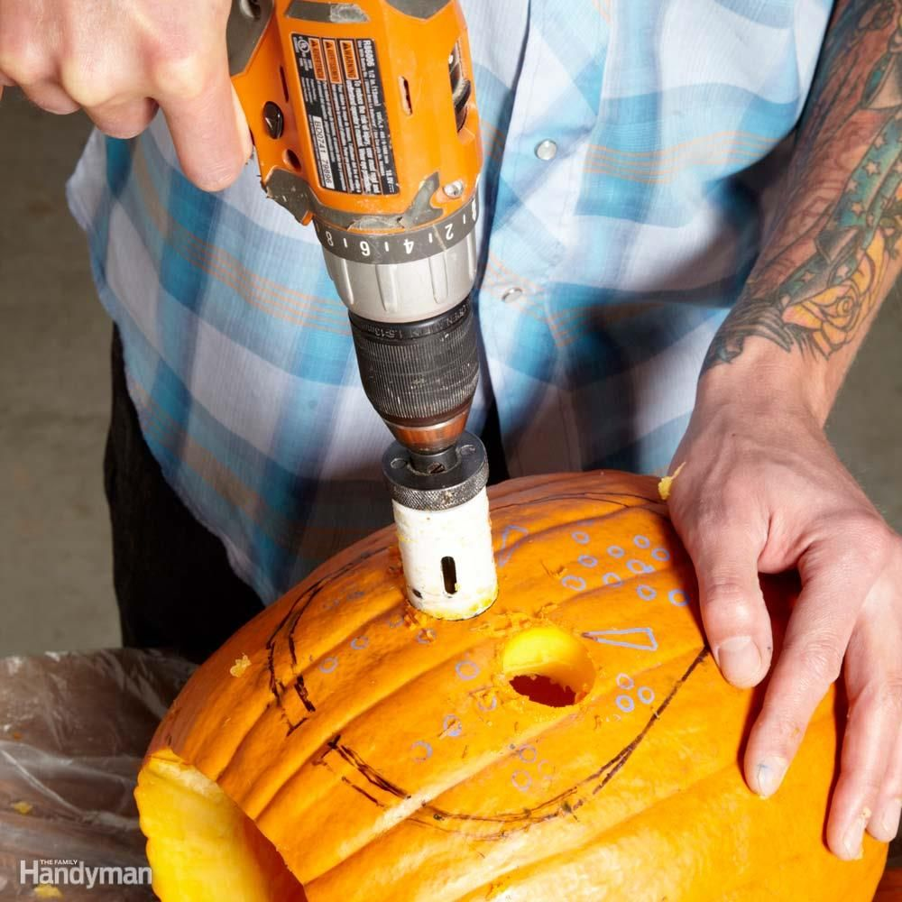 The Perfect Tool For Making Large Circular Holes For The Eyes Is You Guessed It A Hole Saw Let The Weight Of The Dri Pumpkin Carving Pumpkin Design Pumpkin
