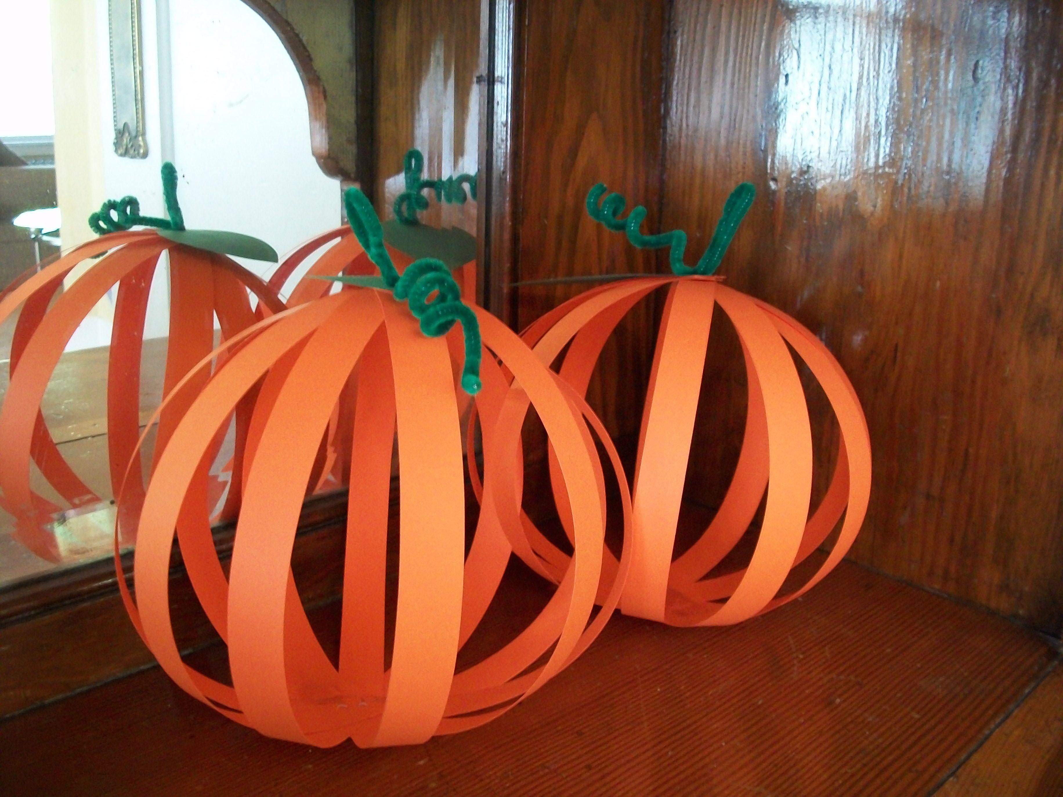 3d pumpkins need orangle construction paper green construction paper 2 paper fasteners per