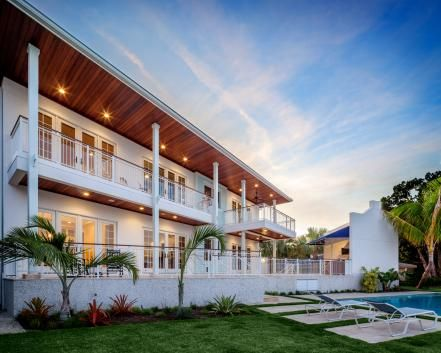 This Tropical Island Inspired Beach Home From Barron Schimberg Features Lush Foliage Crisp Colors And Rich Woods Including A Beautiful Wood Soffit With