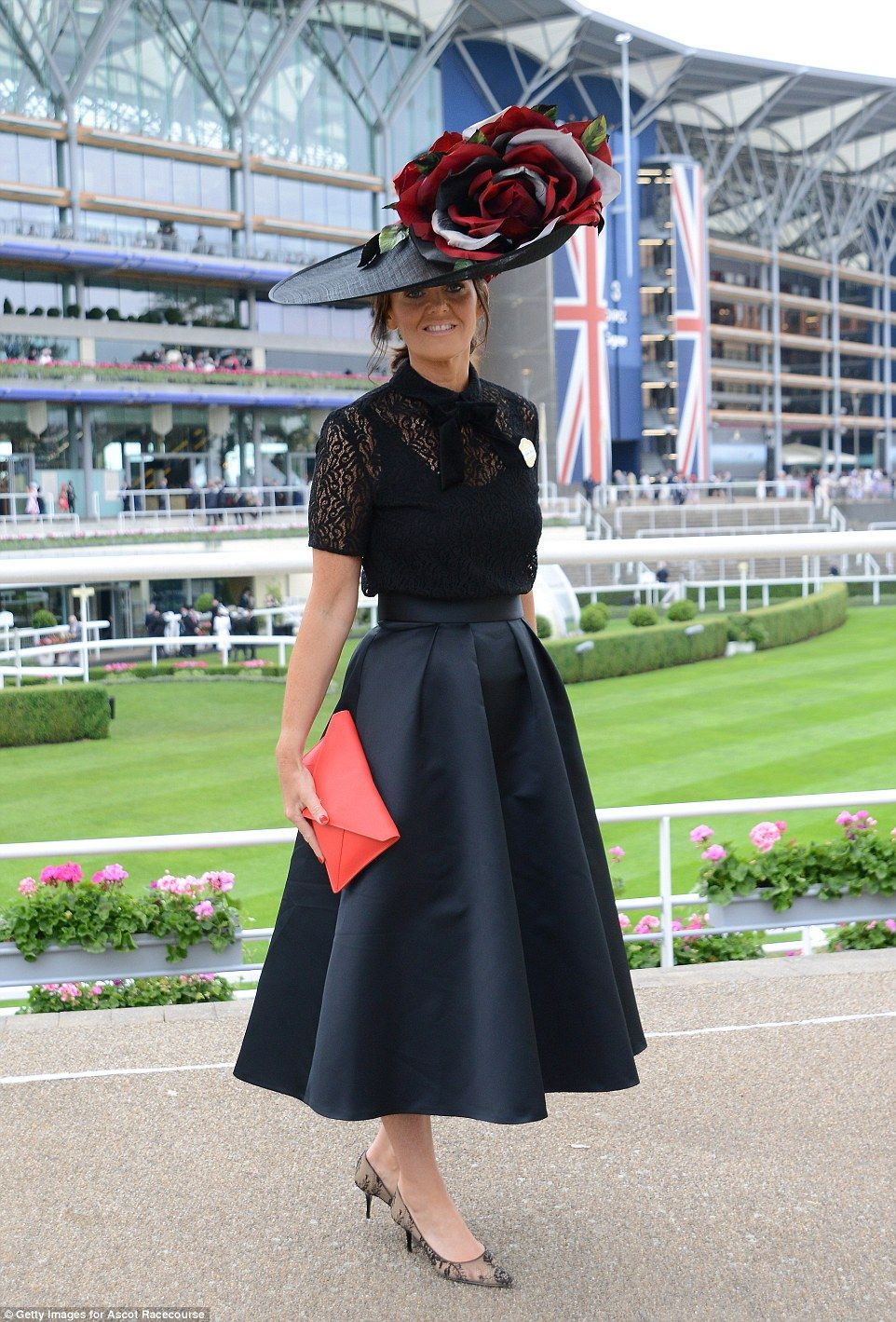 Black dress with touch of red - A Woman S Understated Outfit Of A Black Midi Skirt And Lace Top Got The High Fashion