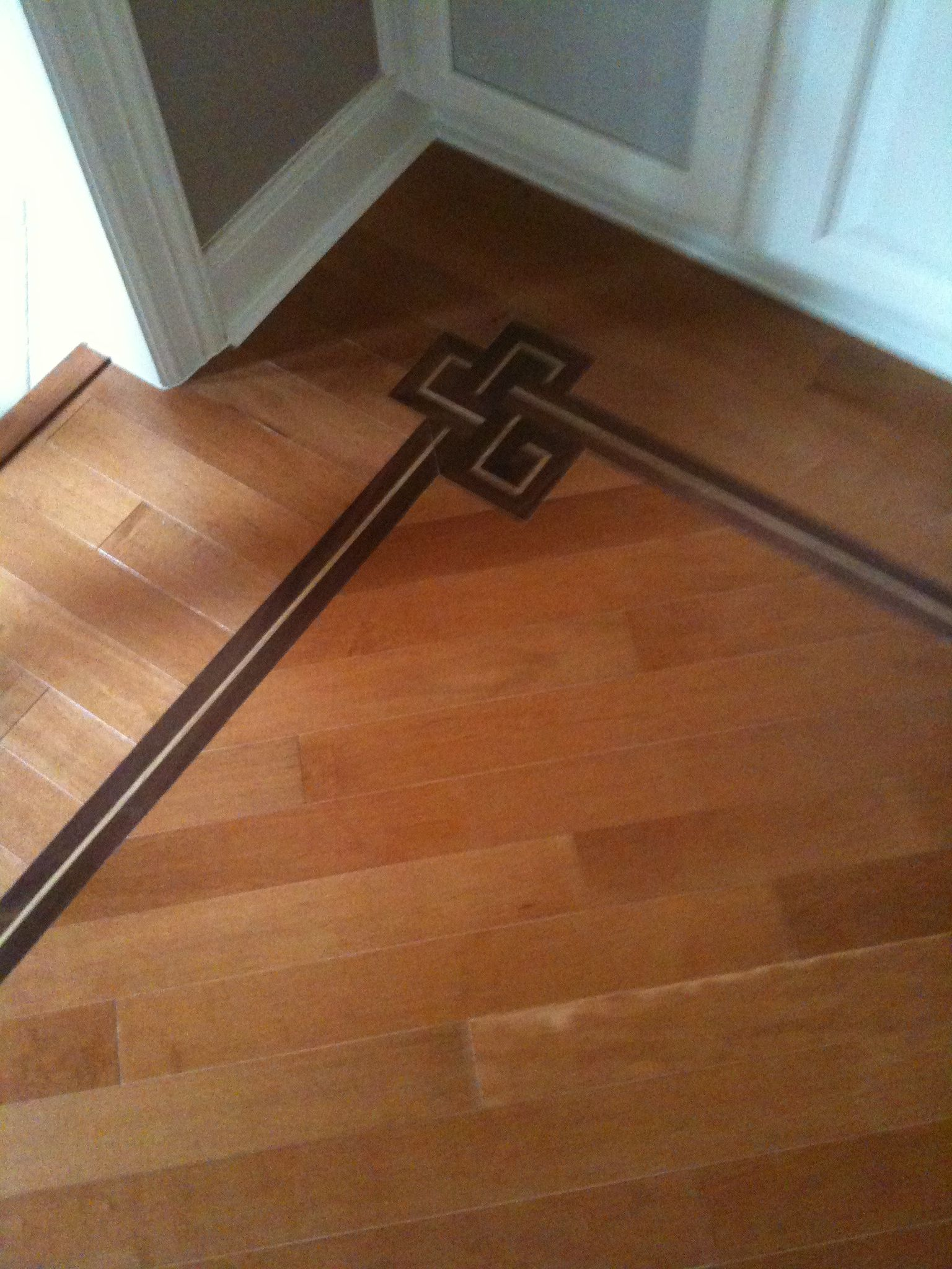 Dark Mahogany Inlaid Accent In Cinnamon Maple Hardwood Flooring