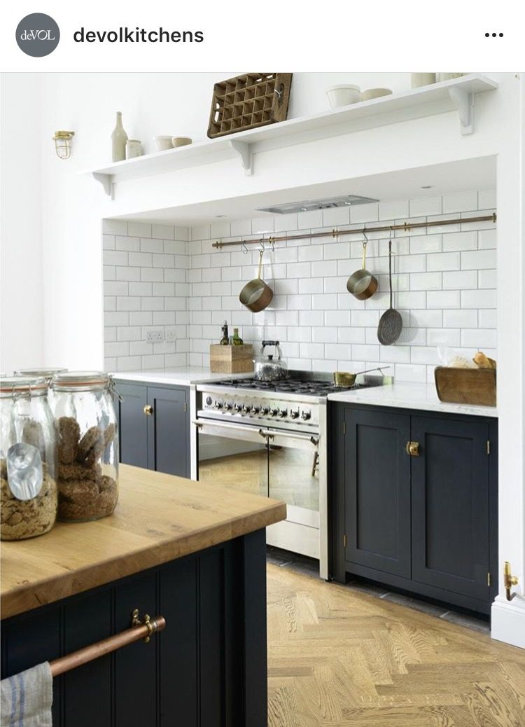 The perfect pair an smeg opera range cooker in stainless steel and beautiful shaker cabinets in pantry blue by devol love the cooker hanging rail