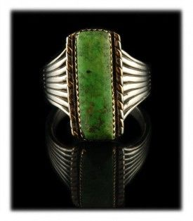 Isn't this a great color of natural lime green in this Gold and Silver Gaspeite Ring by John Hartman.