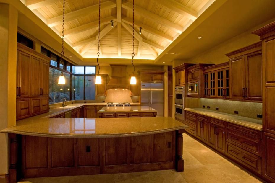 Fantastic Cabinetry And Vaulted Ceilings In This Kitchen Uplighting