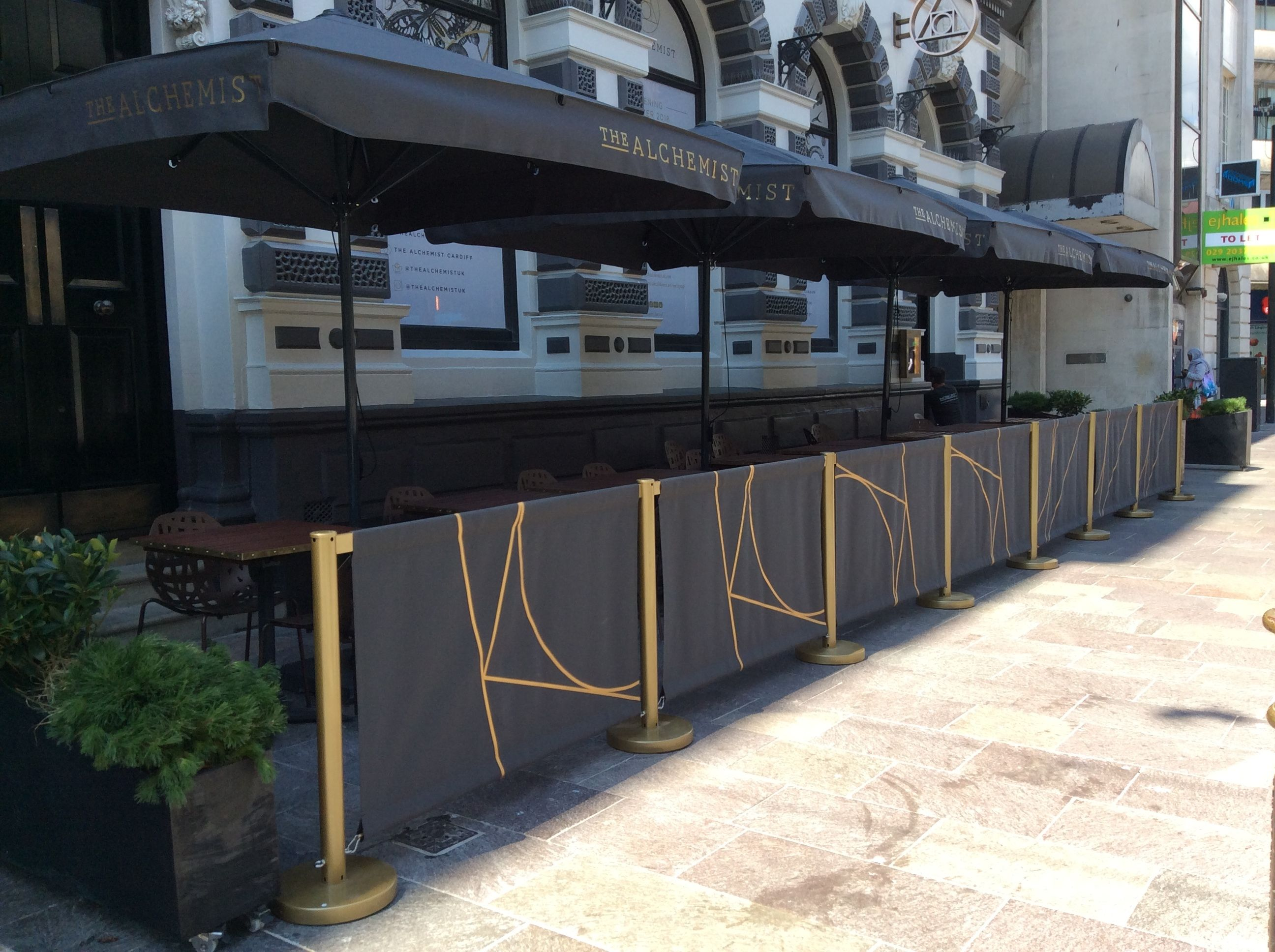 Cafe Barriers With Brass Effect Powder Coated Posts And Contract Grade Parasols By Breezefree Cafebarriers Caf Rooftop Design Cafe Seating Restaurant Seating