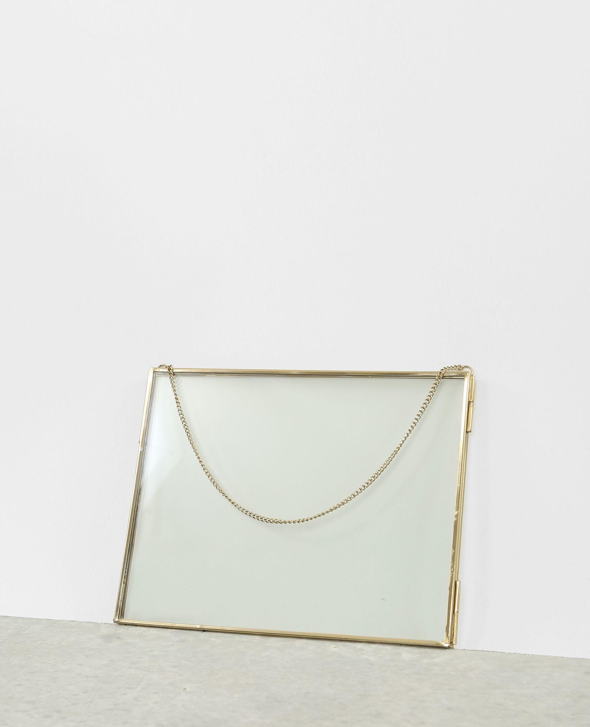 Marco de cristal y metal - Un bonito marco de estilo retro en el que ...