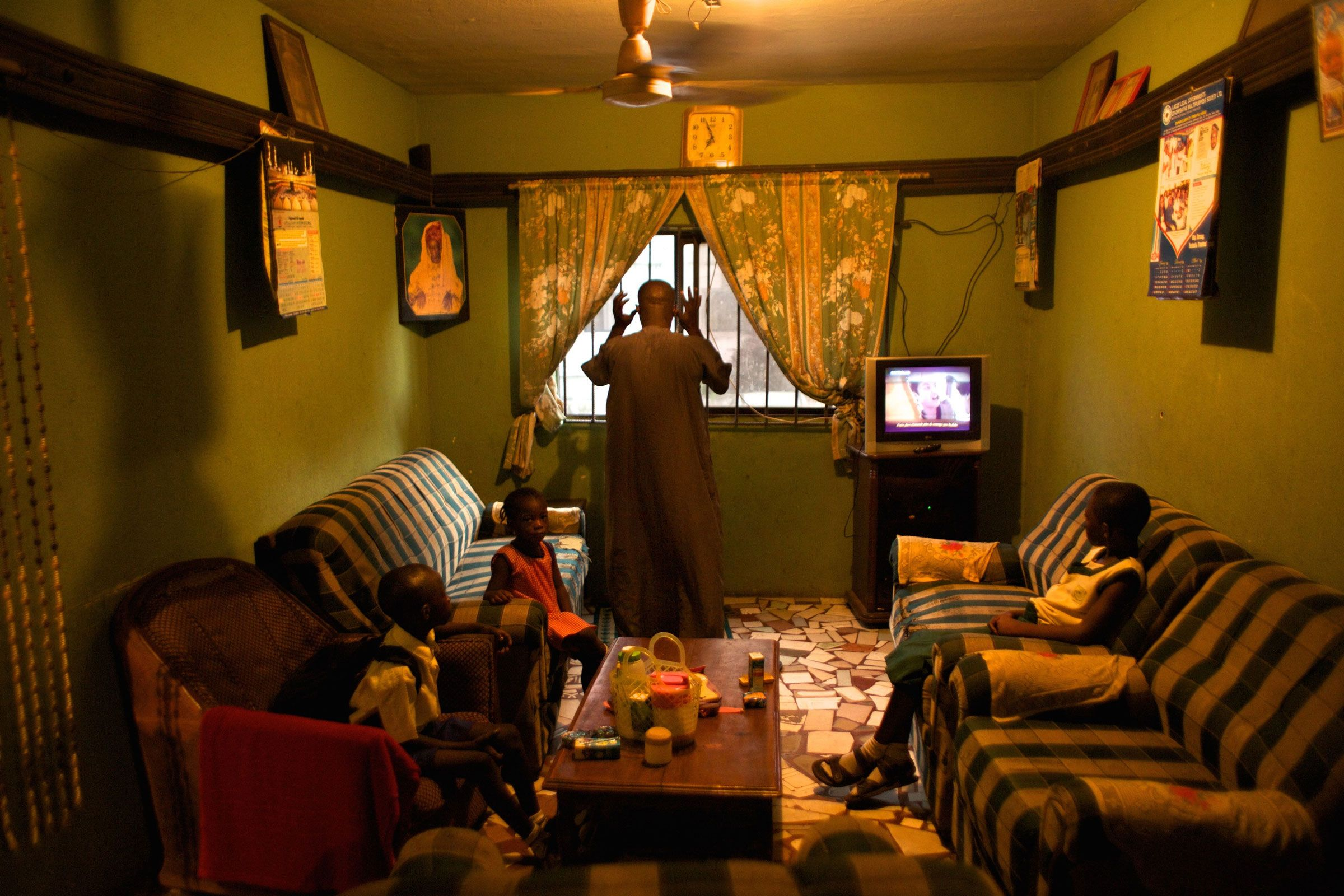 Mr Tajudeen Bakare Is Seen At His Family S Home In Dolphin Estate With His Daughter Hazeezat Bakare 11 Son Hamzat Bakare 8 And Daughter Hammeerat B Spazi