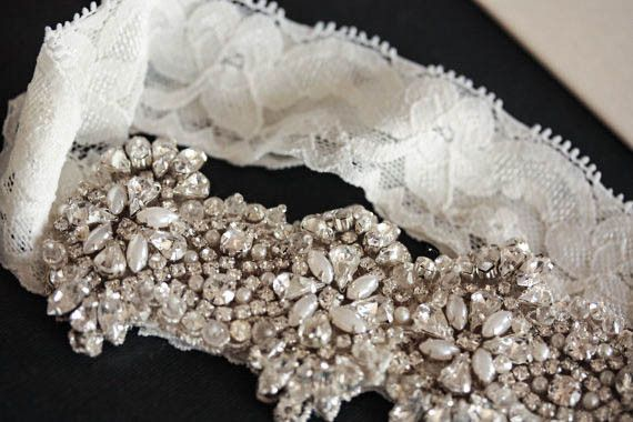 Viva Lace Garter Set  $79.00  * Beaded section is about 5.5 inches in length  * Width of beaded design is 1.5 to 1.8 inches  * Ivory lace measuring 1.5 inch in width  * Stretch from 14 inches to 18 inches  ( if you require a specific length, please do add a note on the order)  * A simple toss garter is included