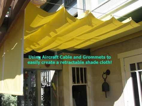 DIY SIMPLE RETRACTABLE SHADE CLOTH! Use a wire cable set, place grommets where you want the peaks, and slide thru the cable! See my other pin: DIY RETRACTABLE SHADE AWNING FOR UNDER $200! for more tips!