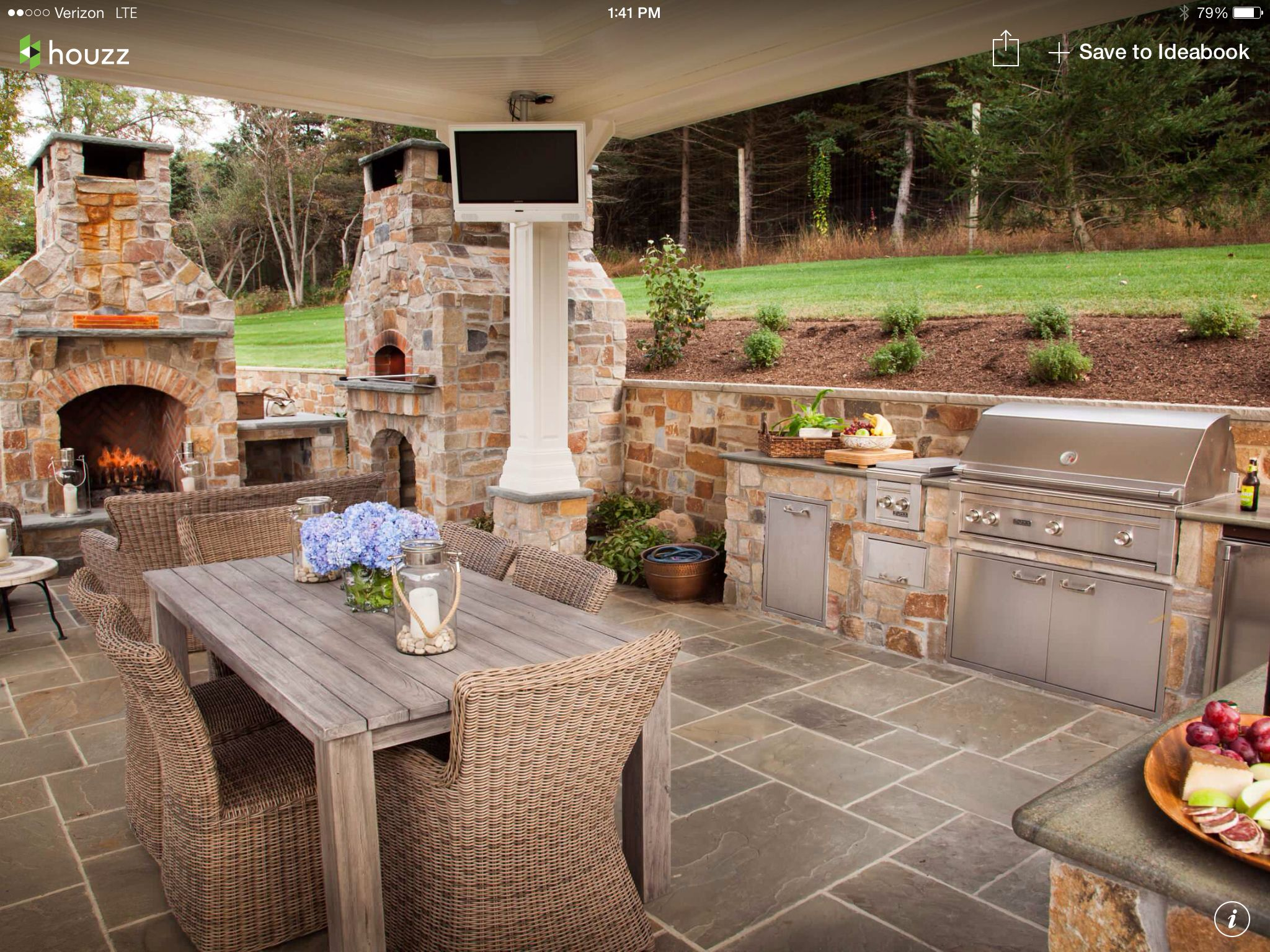 Outdoor kitchen surrounded by beautiful landscaping
